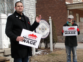 Jesse Cullen joins other protestors outside Oshawa MPP Jerry Ouellette's office in a rally to raise Ontario's minimum wage.